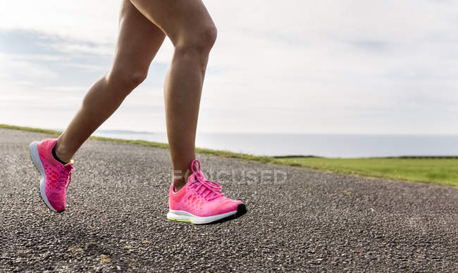 Asturias, Spain, runner woman training outdoors, low section — Stock Photo