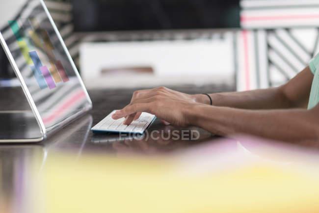 Man working on futuristic computer — Stock Photo