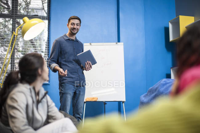 Colleagues discussing in casual boardroom — Stock Photo