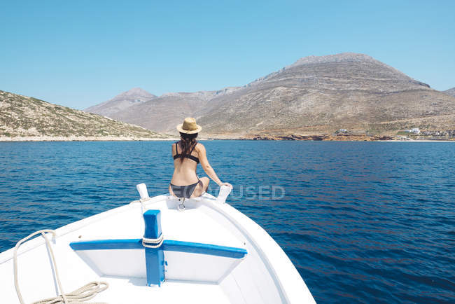 Bow Of A Boat >> Greece Woman Sitting On Bow Of A Boat And Looking At Amorgos Island