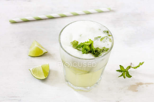 Homemade melon lemonade with ment and lime — Stock Photo