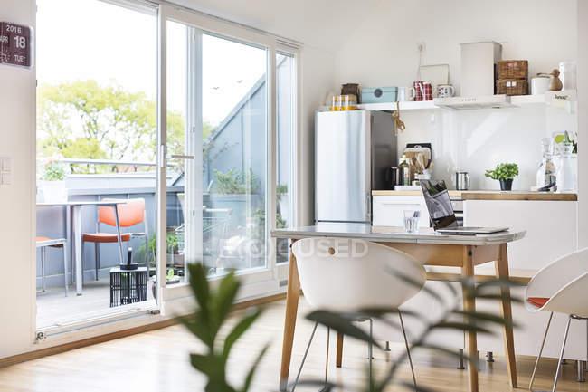 Kitchen and balcony — Stock Photo