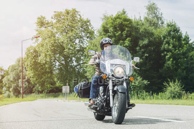 Biker driving on road — Stock Photo