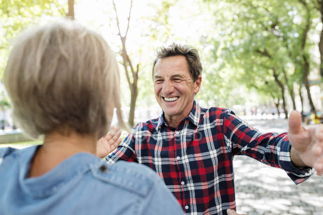 Happy cute senior couple hugging at park — Stock Photo