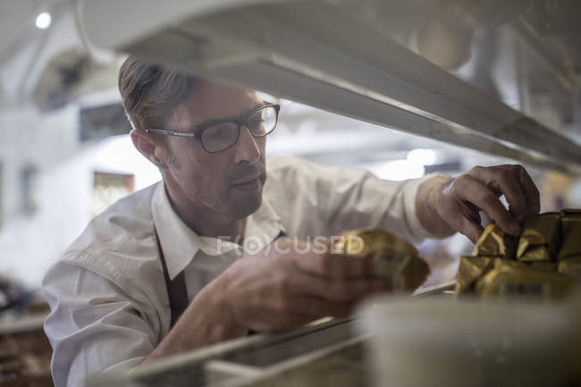 Closeup of male grocer in glasses at work — Stock Photo