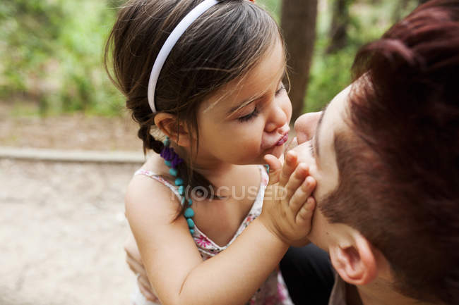 Mother and little daughter cuddling and kissing — Stock Photo