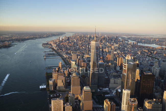 Aerial photograph of New York City and Manhattan Island from above New York Harbor. The Hudson River is on the left side of the frame and the new Freedom Tower dominates the skyline, USA — Stock Photo