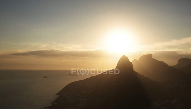 Brazil, Rio de Janeiro, Sunrise on the Atlantic Ocean shoreline — Stock Photo