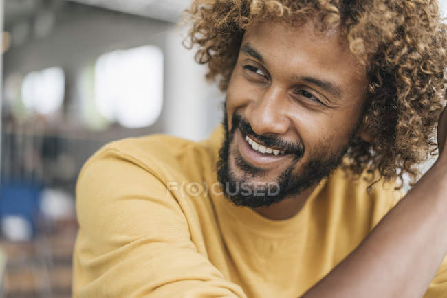 Portrait of Smiling young man with Afro curls — Stock Photo