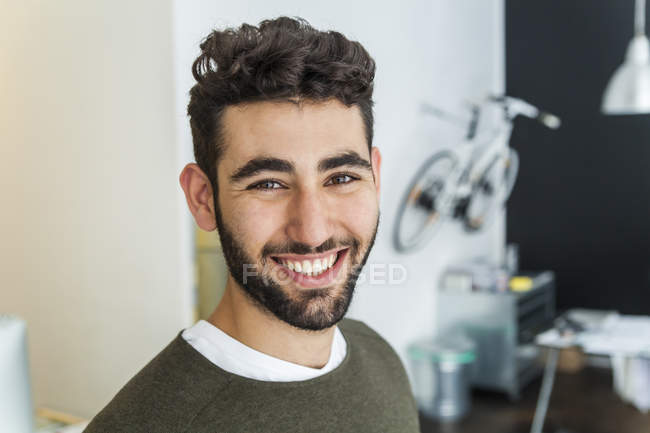 Portrait of content man standing in a modern office — Stock Photo