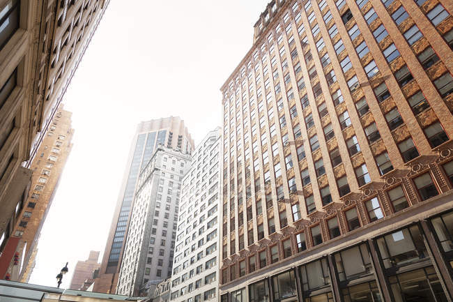 USA, New York City, cityscape with facades of high-rise buildings — Stock Photo