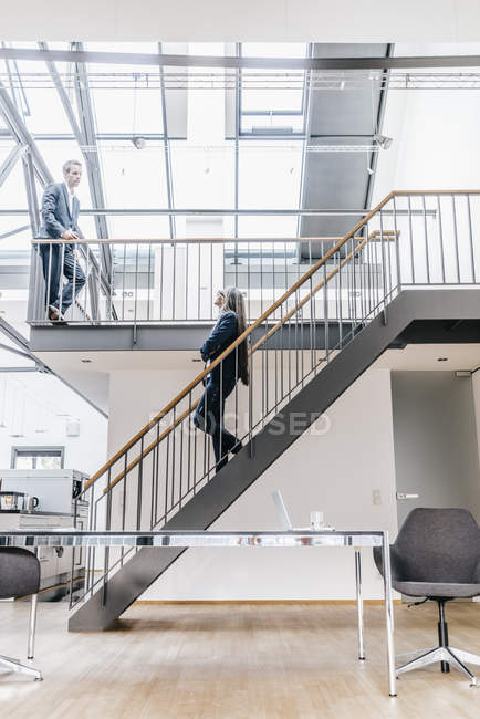 Businesswoman and businessman in a loft — Stock Photo