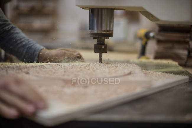 Cropped image of craftsman drilling wood — Stock Photo