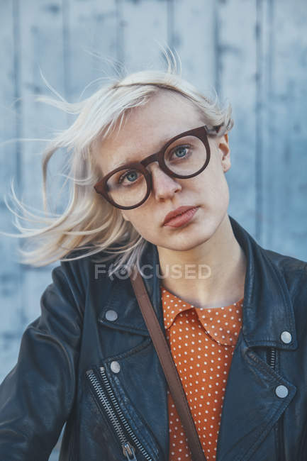 Portrait of young woman with windswept hair — Stock Photo
