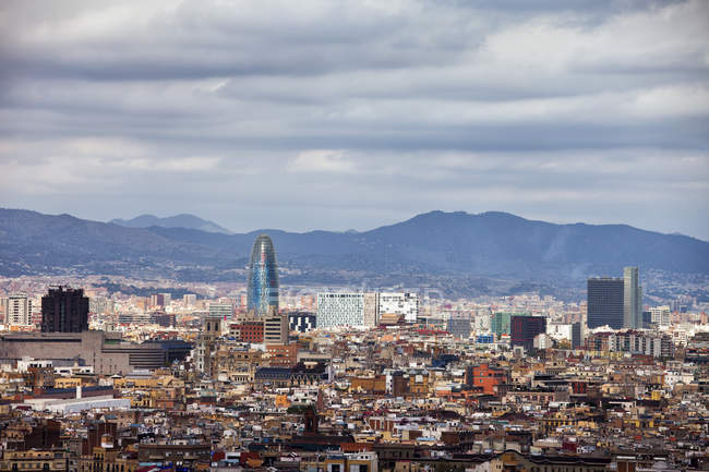 Spain, Barcelona, cityscape against hill during daytime — Stock Photo