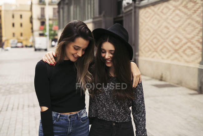 Two happy best friends arm in arm in autumn — Stock Photo