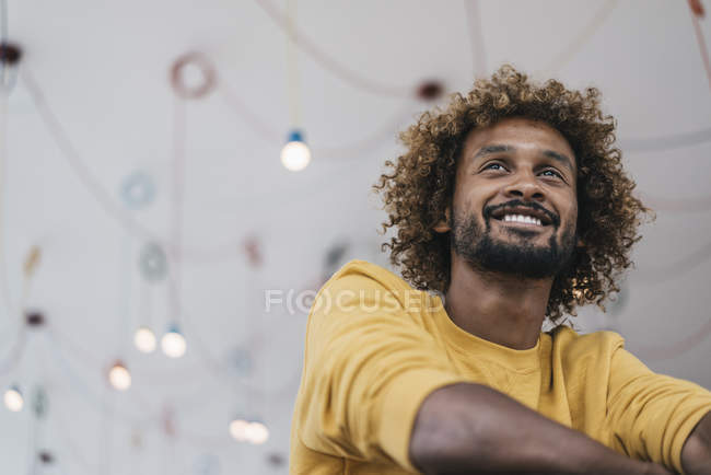 Smiling young man with Afro curls — Stock Photo