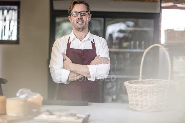 Portrait of grocer in a farm shop — Stock Photo