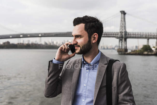 Businessman telephoning on ferry on East River, New York City, USA — Stock Photo