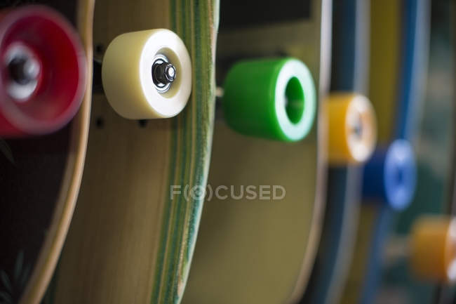 Various skateboards in shop on blurred background — Stock Photo