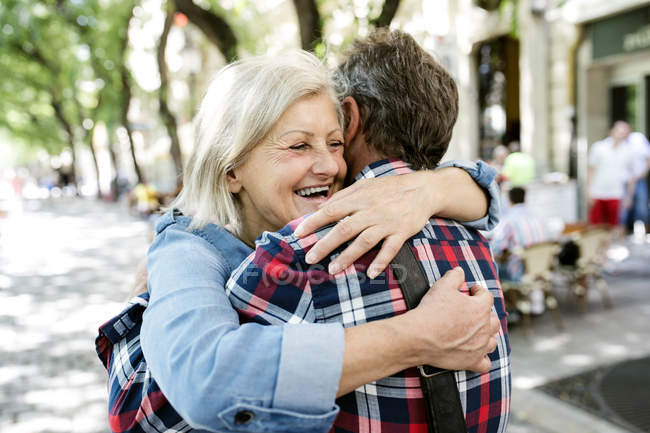 Happy cute senior couple hugging each other outdoors — Stock Photo