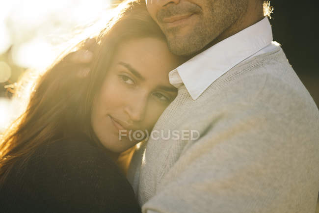 Portrait of happy woman with head on husband shoulder — Stock Photo