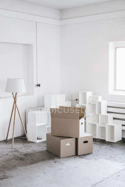 Cardboard boxes in empty loft — Stock Photo