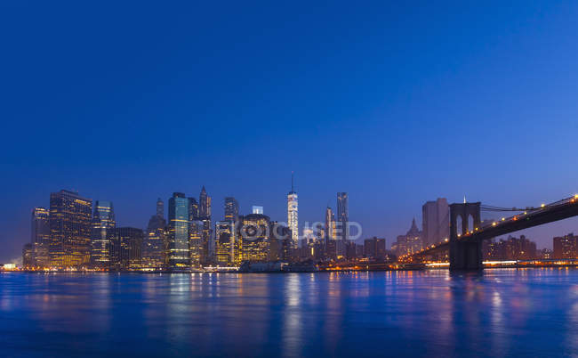 USA, New York City, Manhattan, view to financial district illuminated at dawn — Stock Photo