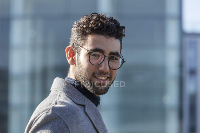 Portrait of smiling young businessman with beard and spectacles — Stock Photo