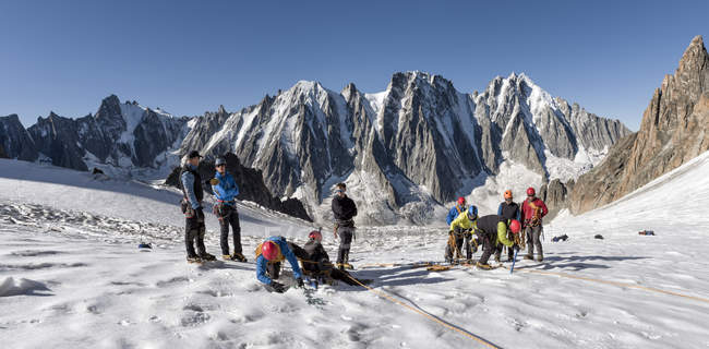 France, Chamonix, Argentiere Glacier, les Droites, Les Courtes, Aiguille Verte, group of mountaineers preparing for climbing — Stock Photo