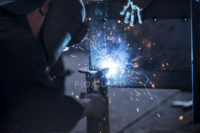Close-up of two welders at work in workshop — Stock Photo