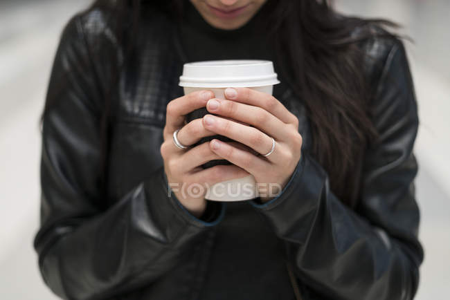 Close-up of Woman holding take away cup of coffee — Stock Photo