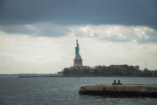 USA, New York City, Statue of Liberty on Liberty Island in clouds — Stock Photo
