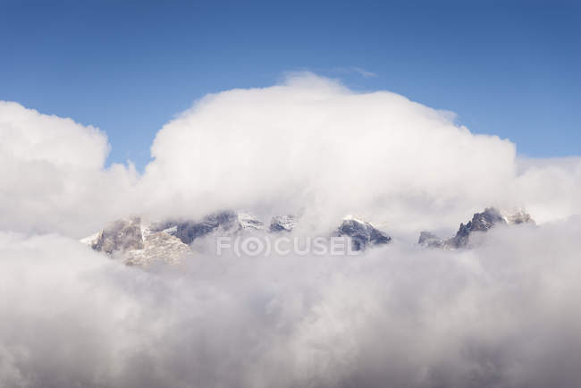 USA, Wyoming, clouds covering Teton Range — Stock Photo