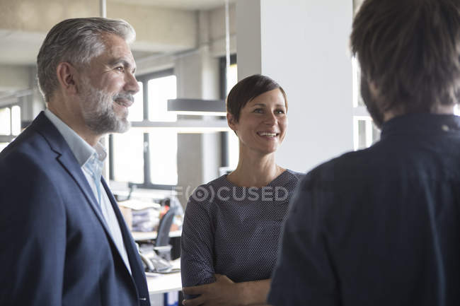 Smiling Business people talking in office — Stock Photo