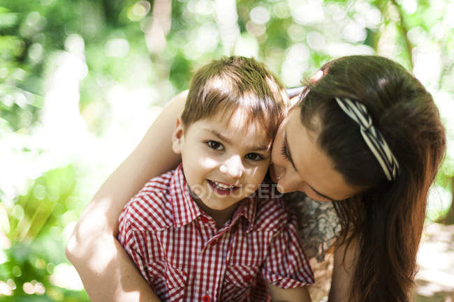 Portrait of happy little boy with his mother in nature — Stock Photo