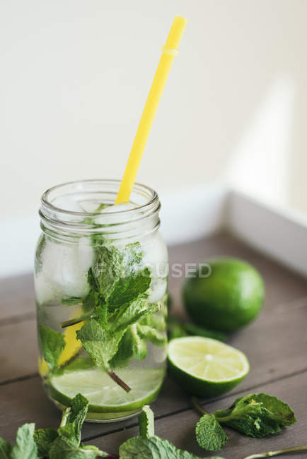 Closeup of fresh Mojito in glass with drinking straw — Stock Photo