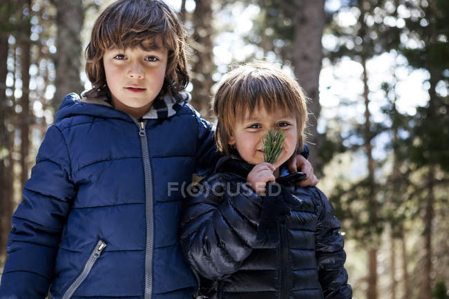 Portrait of two little boys in the woods — Stock Photo