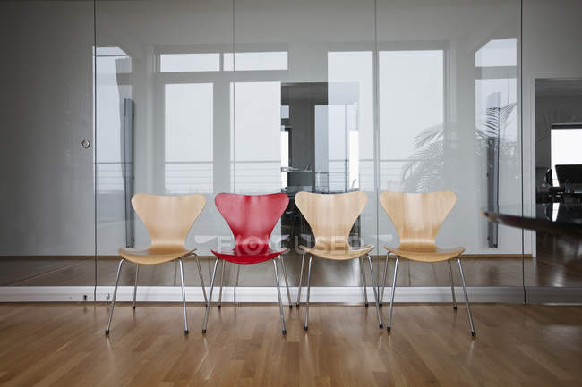 Row of empty chairs in office — Stock Photo
