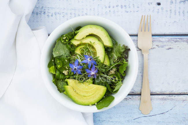 Detox bowl of lettuce and star-flowers — Stock Photo
