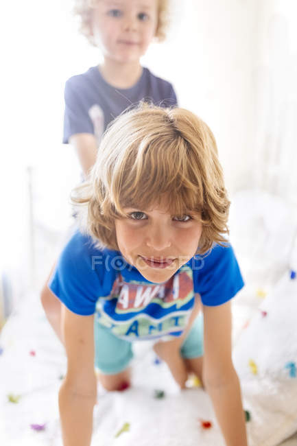 Portrait of smiling boy playing with his little brother at home — Stock Photo