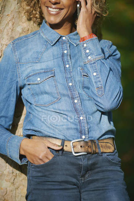 Woman wearing denim shirt, partial view — Stock Photo