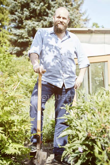 Young man working garden — Stock Photo