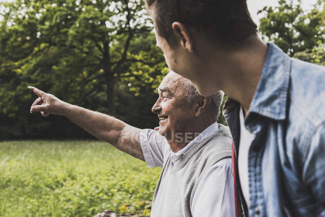 Happy grandfather and grandson in nature — Stock Photo