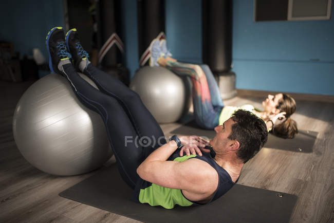 Mature couple training with fitness ball, Abdominal exercises — Stock Photo