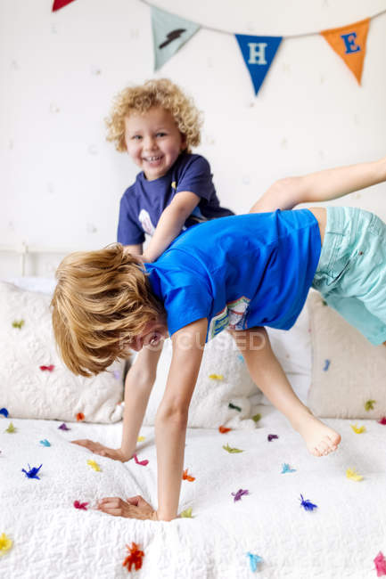 Little boy playing with his big brother at home — Stock Photo
