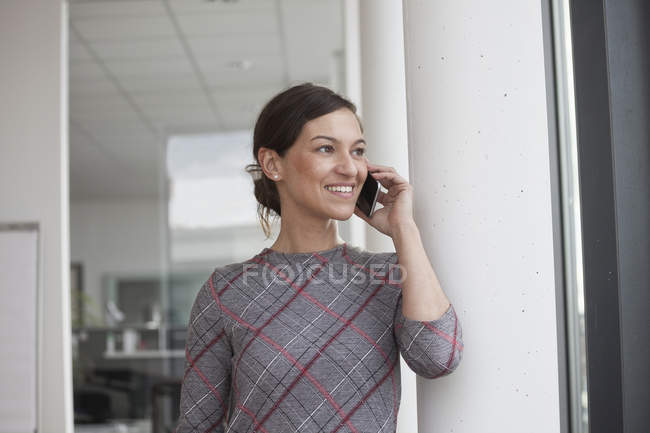 Businesswoman on cell phone — Stock Photo