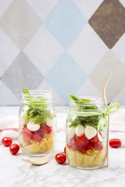 Calabrese salad with pasta in jars — Stock Photo