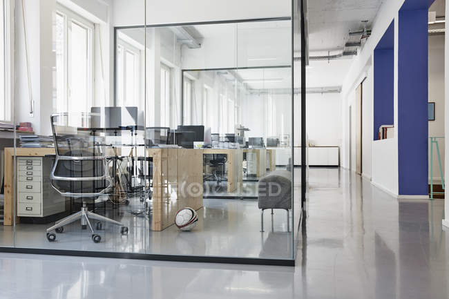 Interior of bright modern office with separate glass rooms — Stock Photo