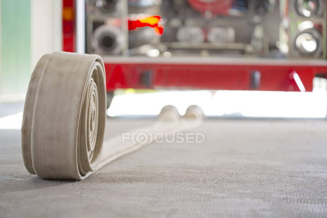 Fire hose on floor of fire brigade equipment house — Stock Photo